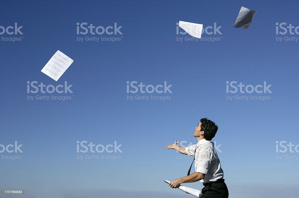 Catching the papers stock photo