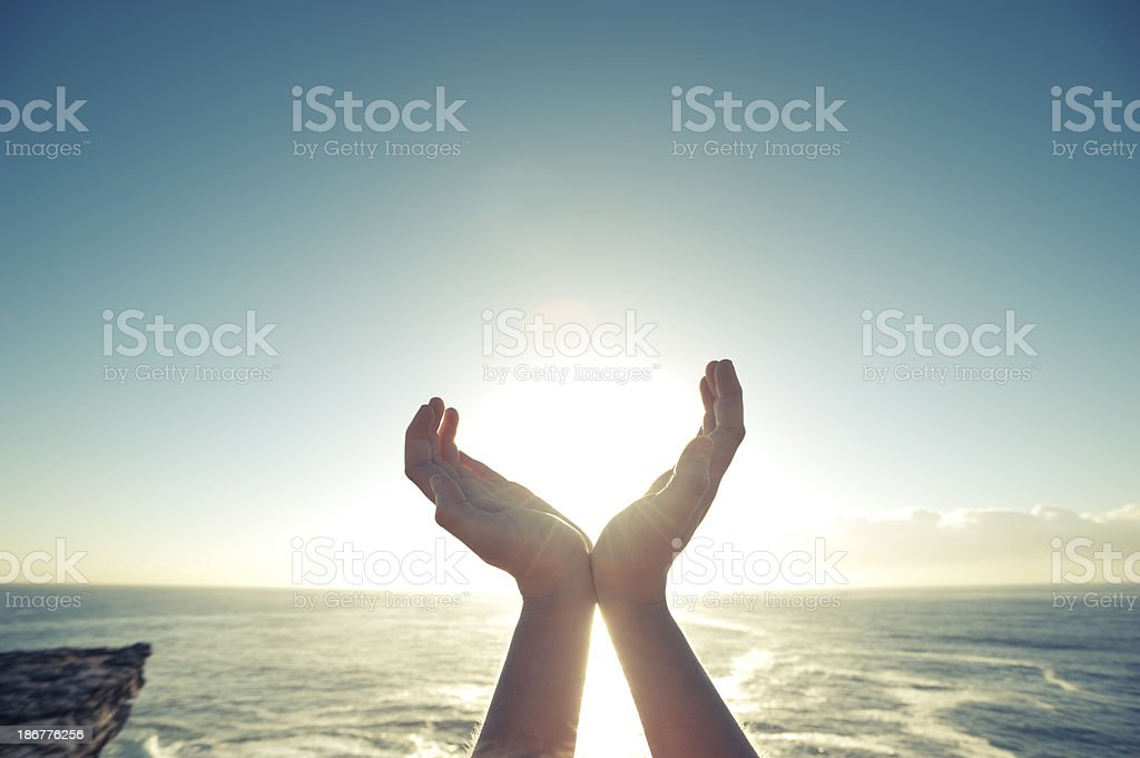 Catching the sun in your hands stock photo