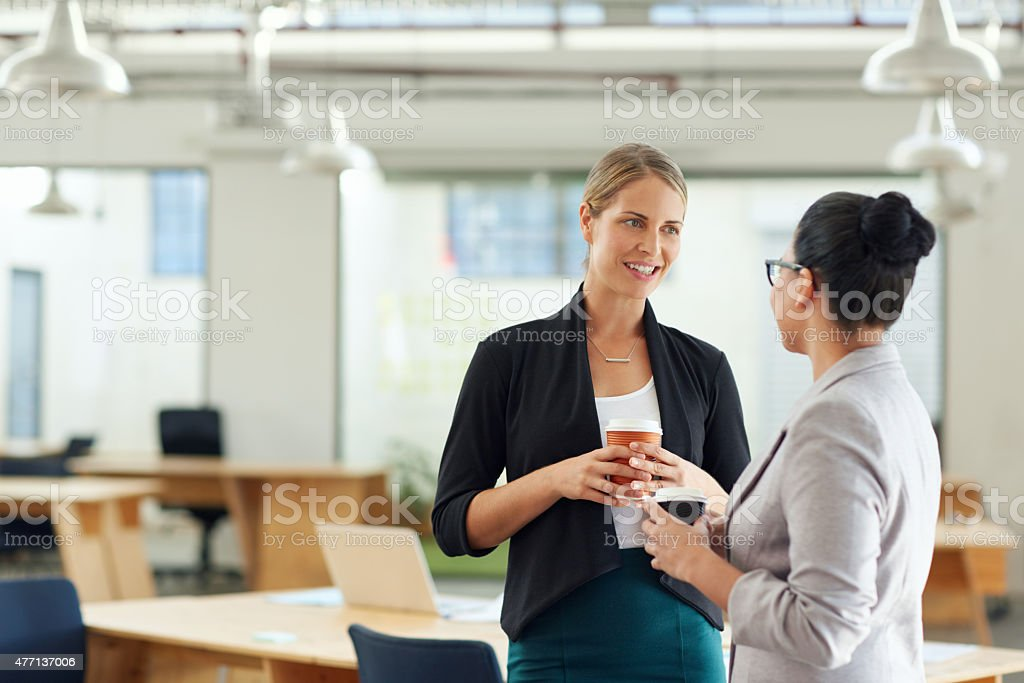 Catching up at the office stock photo