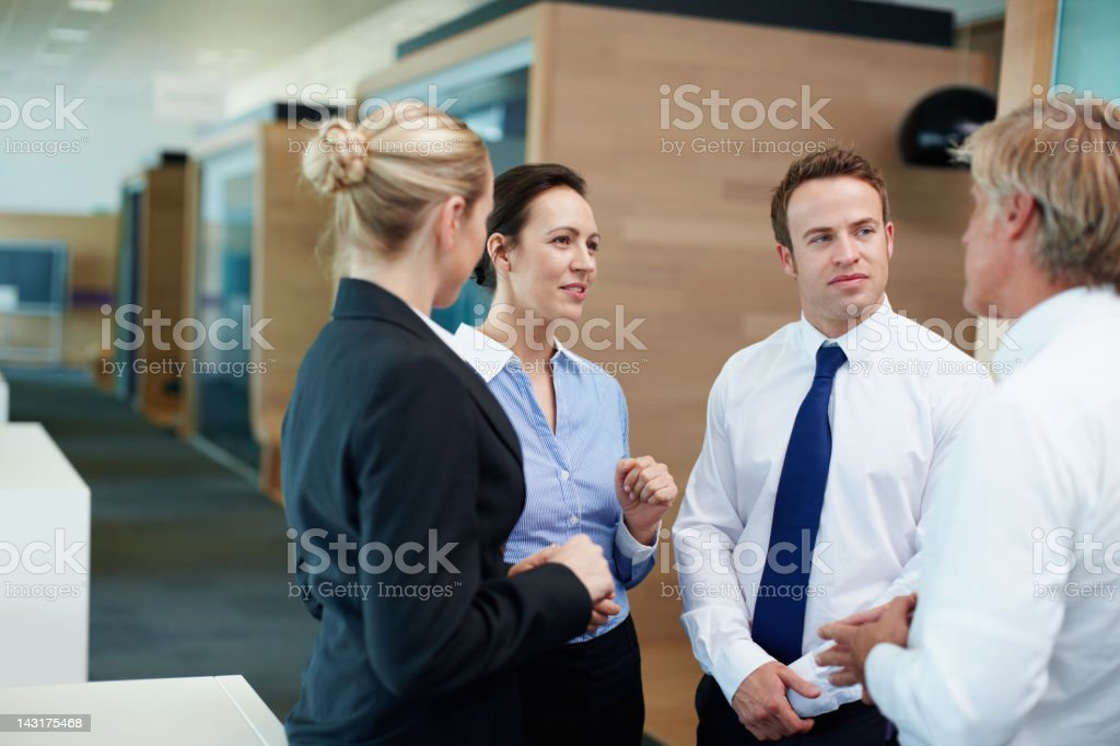 Catching up in the workplace royalty-free stock photo