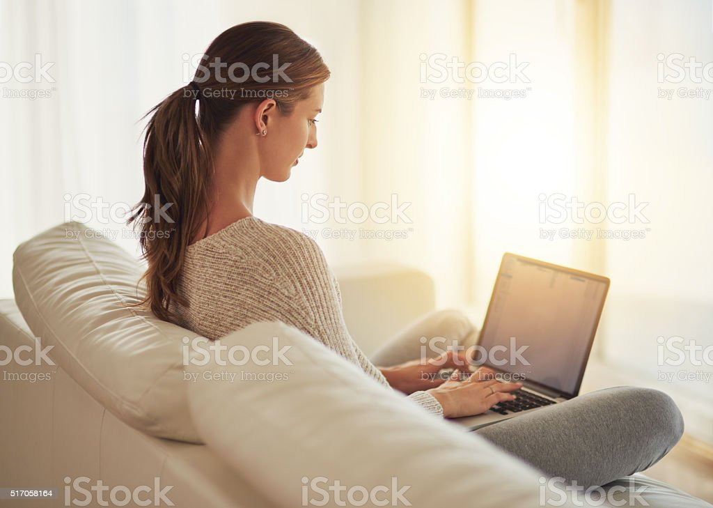 Catching up on all her blogs stock photo