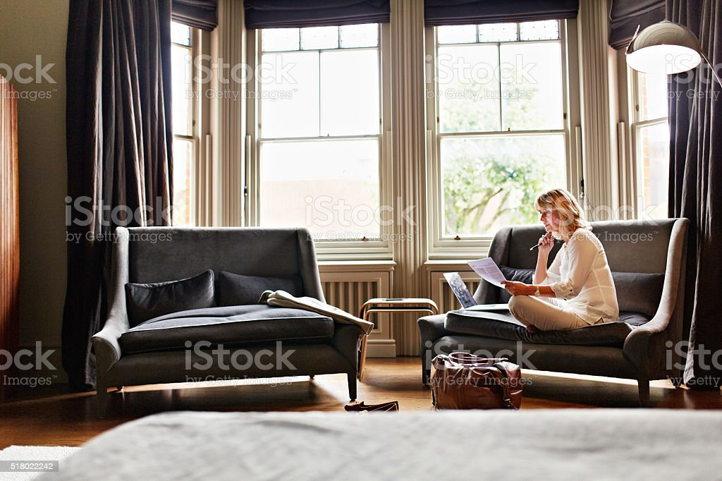 Catching up on her mails after a long trip stock photo