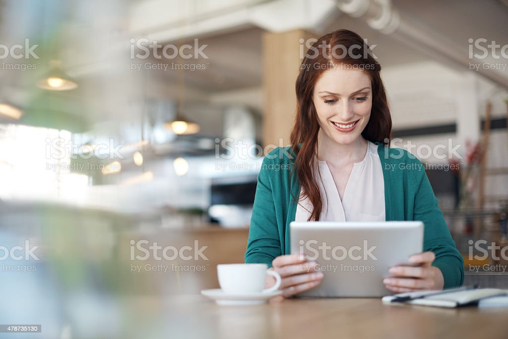 Catching up on social media over some coffee stock photo