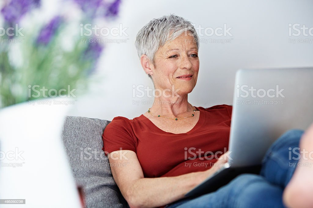 Catching up on some much need time online stock photo