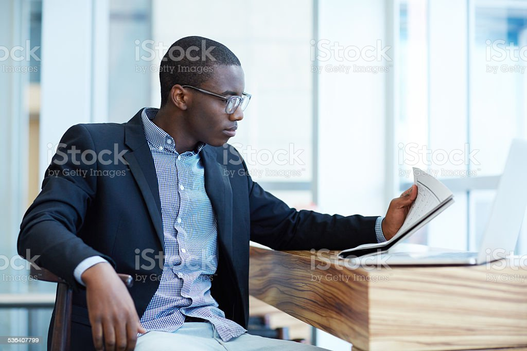Catching up on some news stock photo
