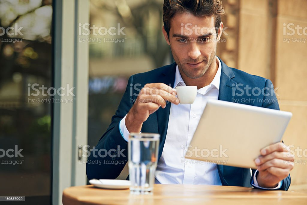 Catching up on some online news before work stock photo