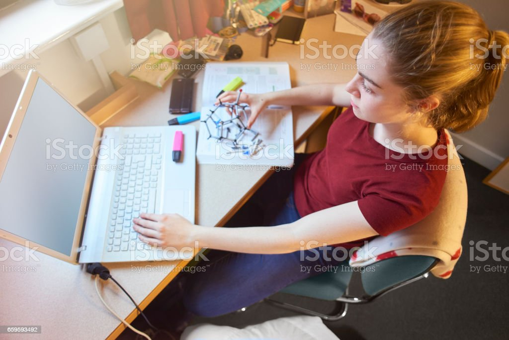 Catching up on some studying in her uni room stock photo