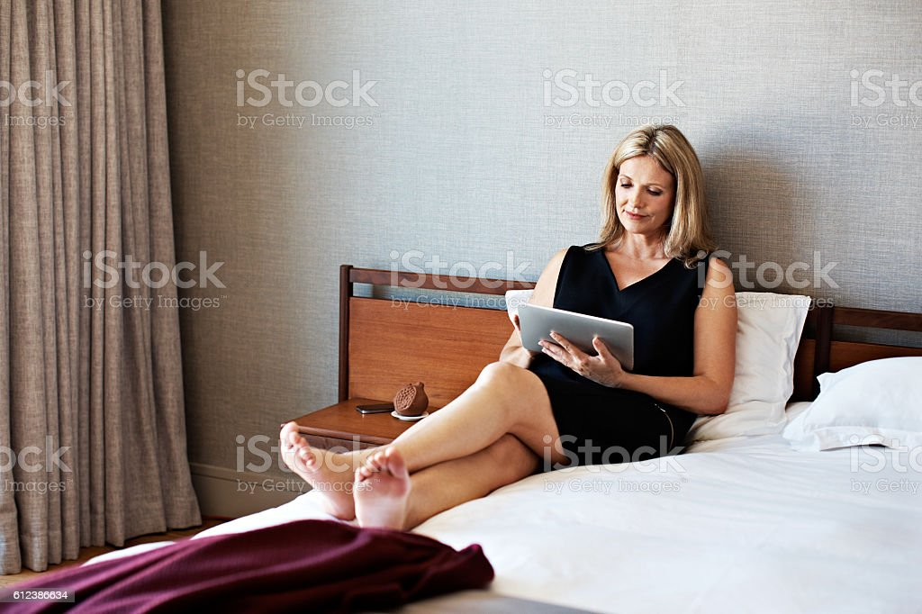 Catching up on some work from the hotel stock photo