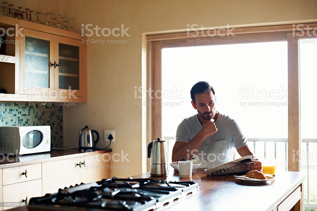 Catching up on the latest headlines over breakfast stock photo