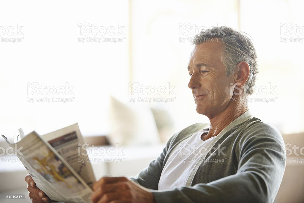 Catching up on the news stock photo