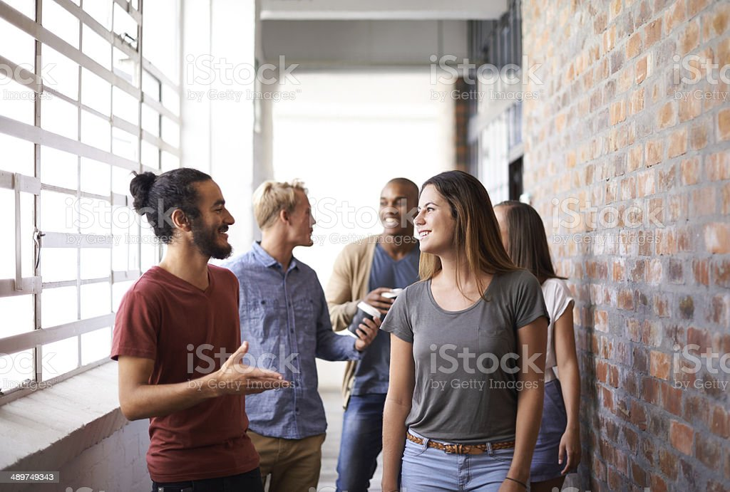Catching up on the way to class stock photo