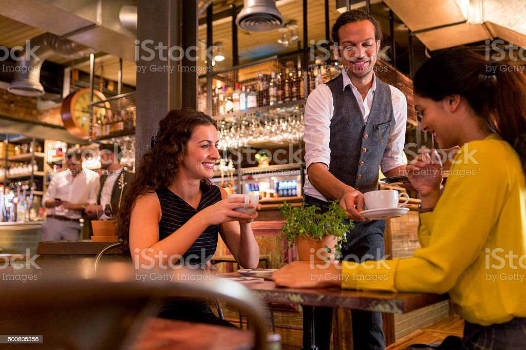 Catching up with friends over a coffee stock photo
