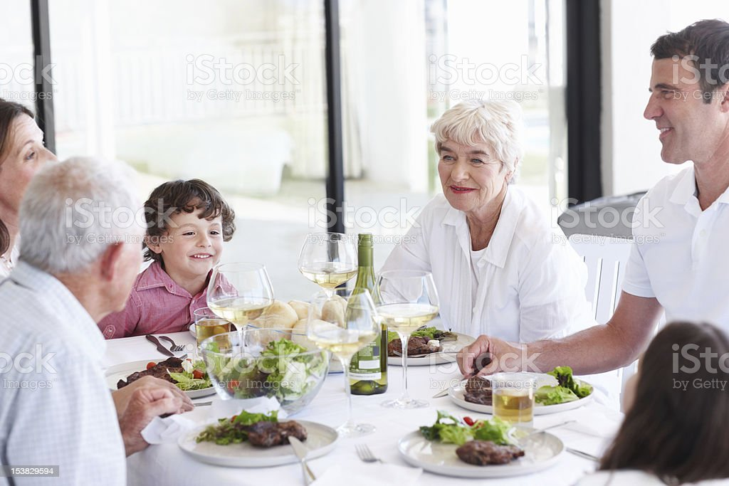 Catching up with the family over a hearty meal royalty-free stock photo