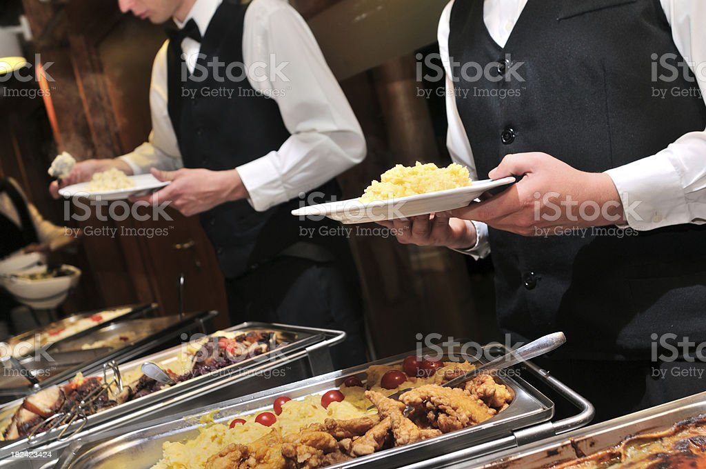 Caterers preparing food ready to be served royalty-free stock photo