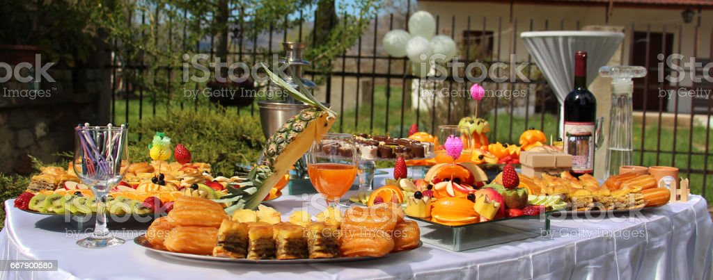 catering banquet table, Buffet with snacks at the outdoor event image