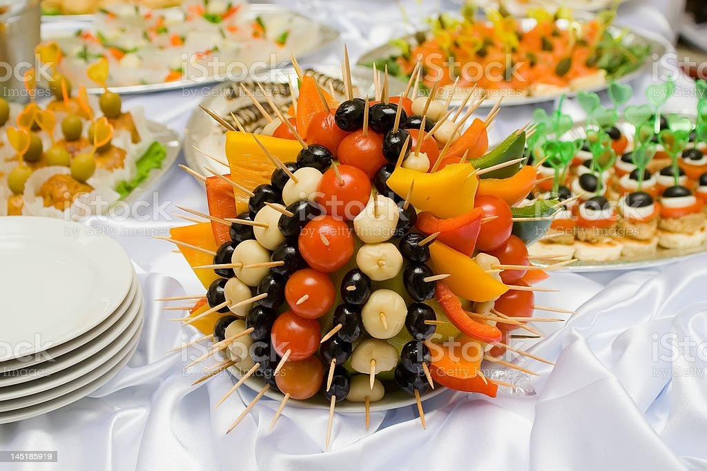 Catering buffet style - tomatoes, olives and mushrooms royalty-free stock photo