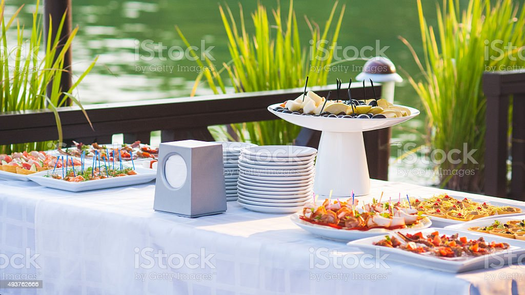 Catering buffet style with different light snack stock photo