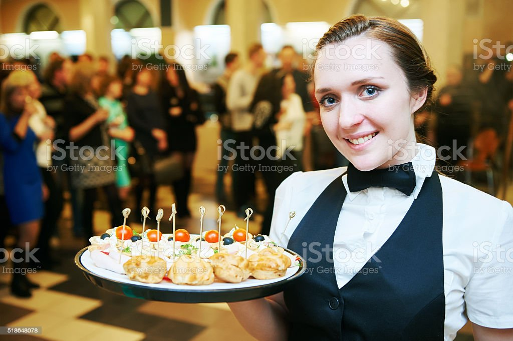 Catering service. waitress on duty stock photo