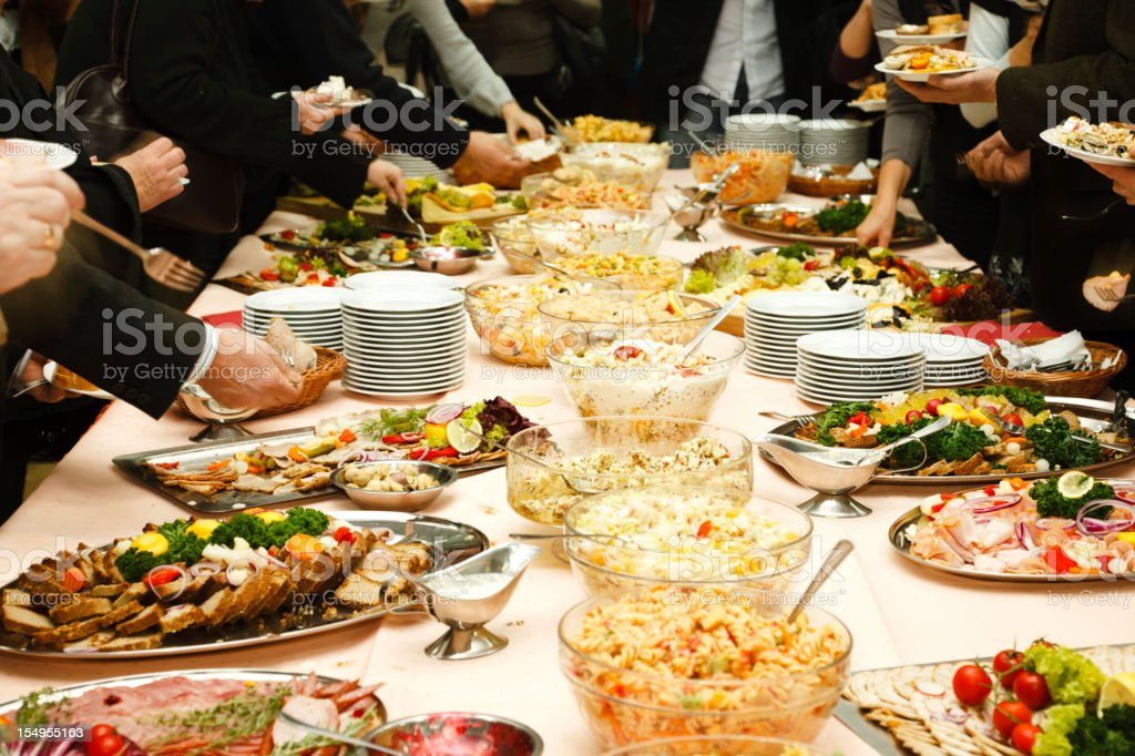 Catering table full of tasty food stock photo