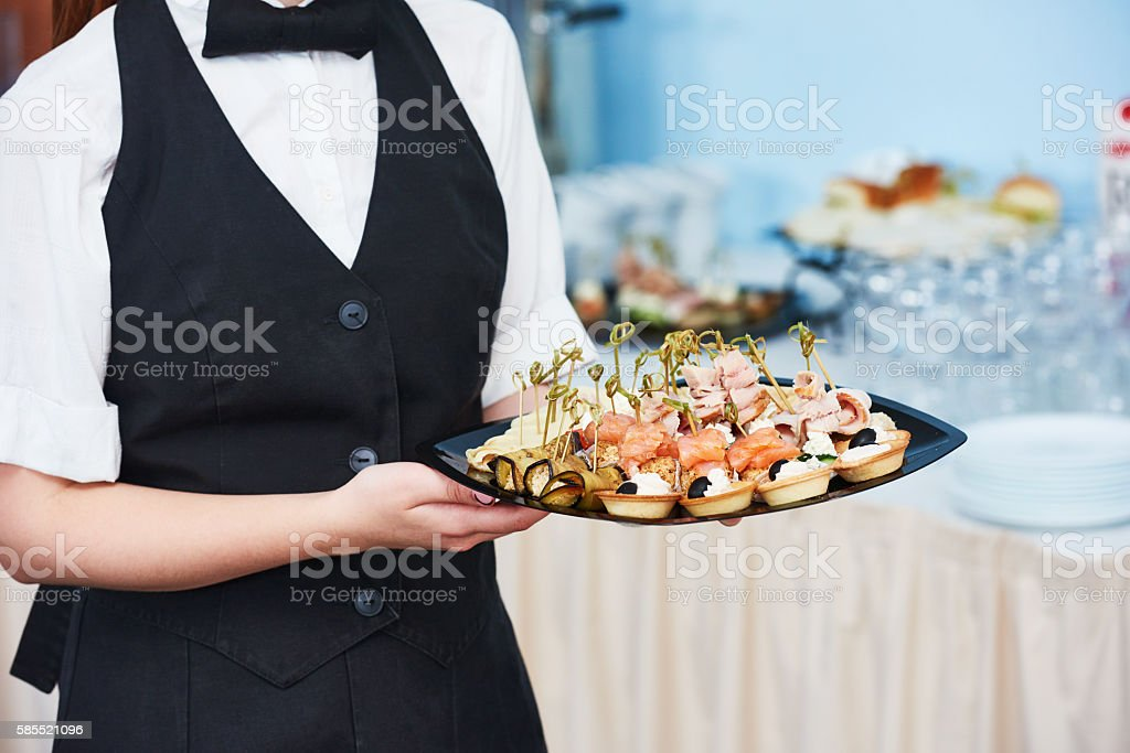 Catering waitress service. woman at restaurant event stock photo