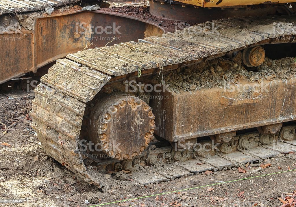 caterpillar of the excavator. Working outdoor Construction heavy stock photo