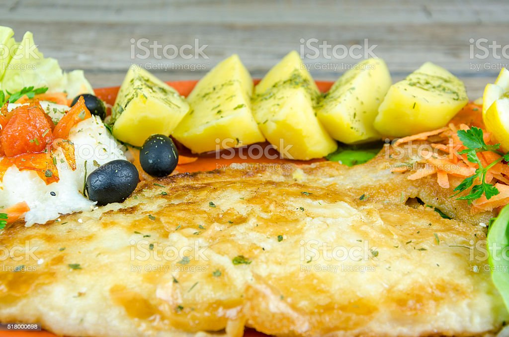 Catfish filet with boiled potatoes stock photo