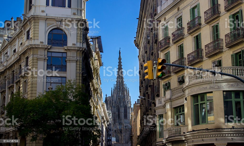 Cathedral between buildings in Barcelona, Spain stock photo