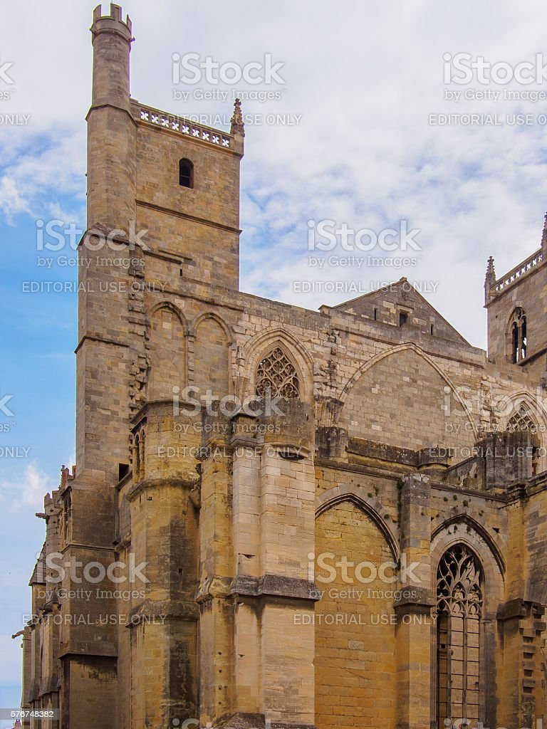 Cathedral of Narbonne on a cloudy spring day stock photo
