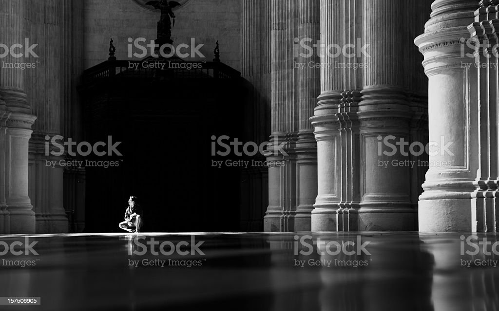 Cathedral sunbeam and person royalty-free stock photo