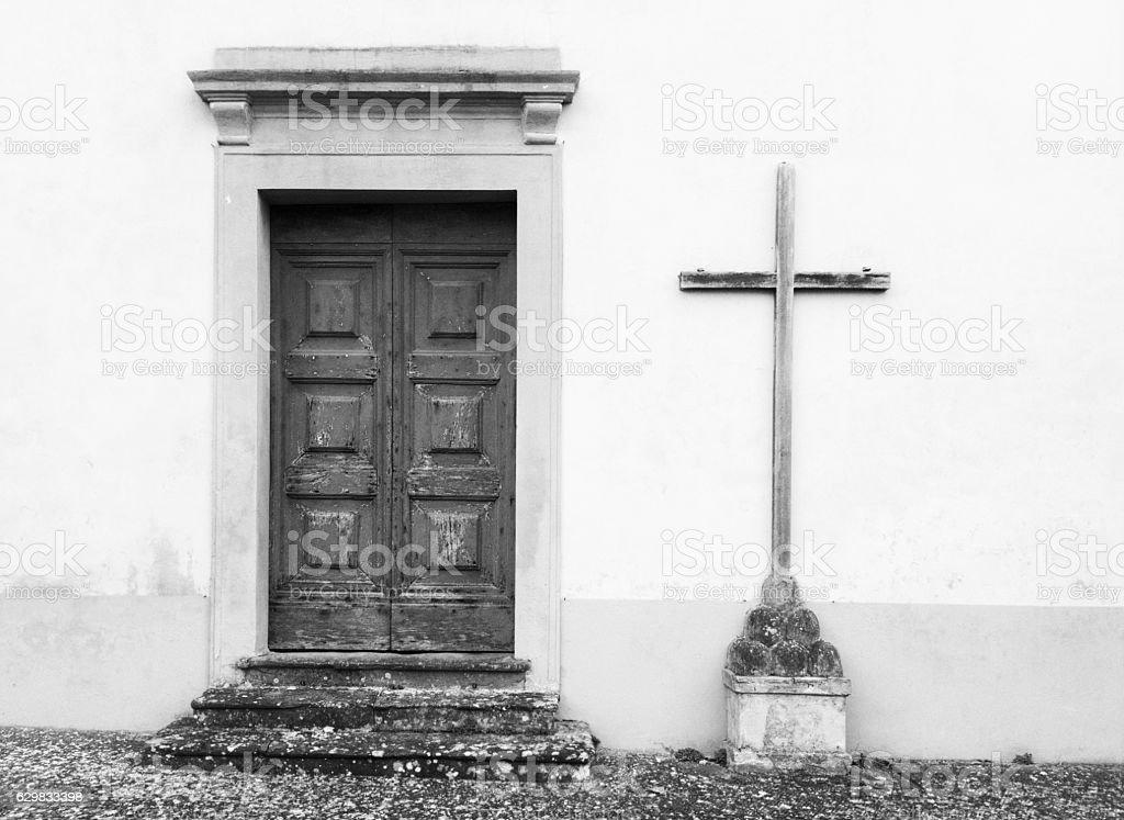 Catholic church entrance: front door and cross stock photo
