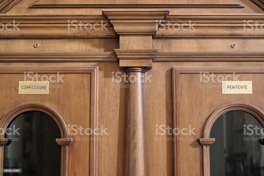 Catholic confessional area - Confessare i peccati stock photo