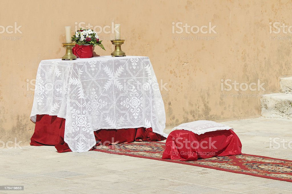 catholic crimson white church altar with candles in Rab Croatia royalty-free stock photo