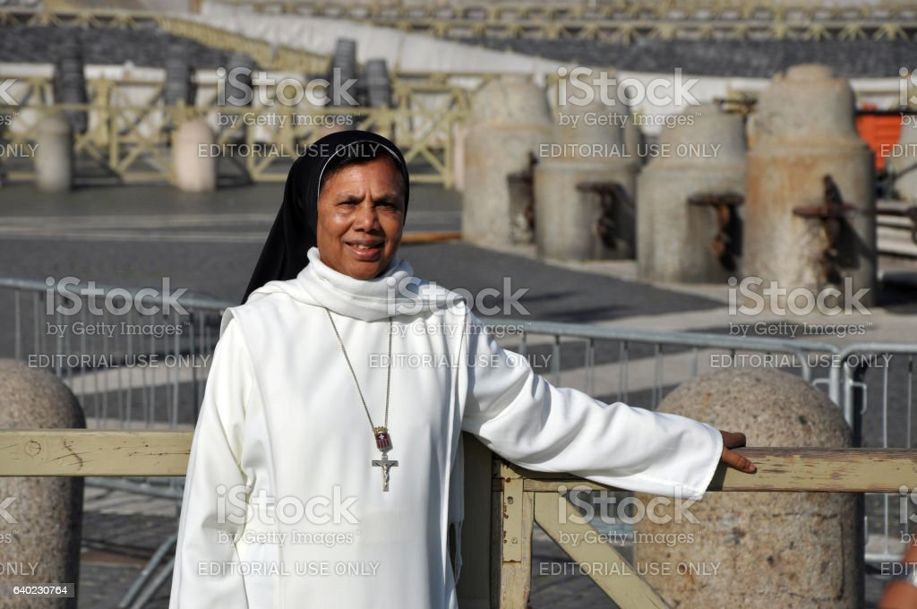 Catholic nun posing in the front of Saint Peter Basilica stock photo