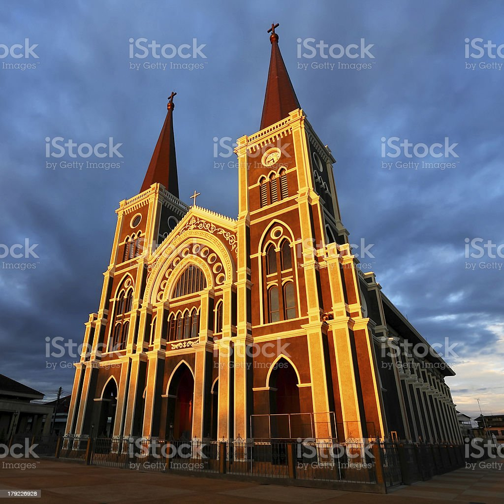 Catholic received the evening golden light royalty-free stock photo