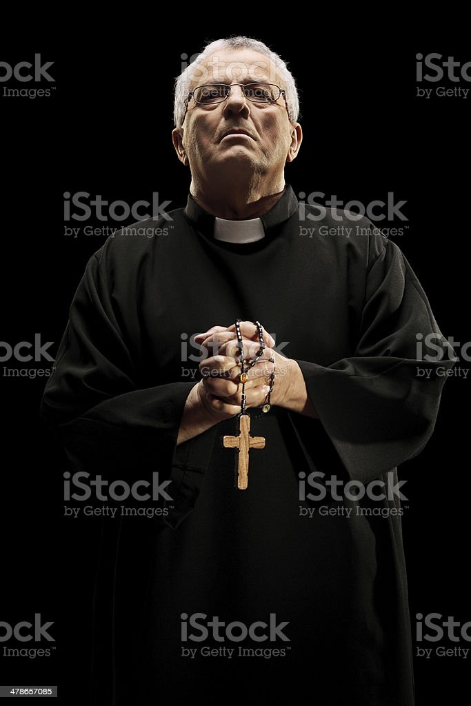Catholic reverend holding a wooden cross stock photo