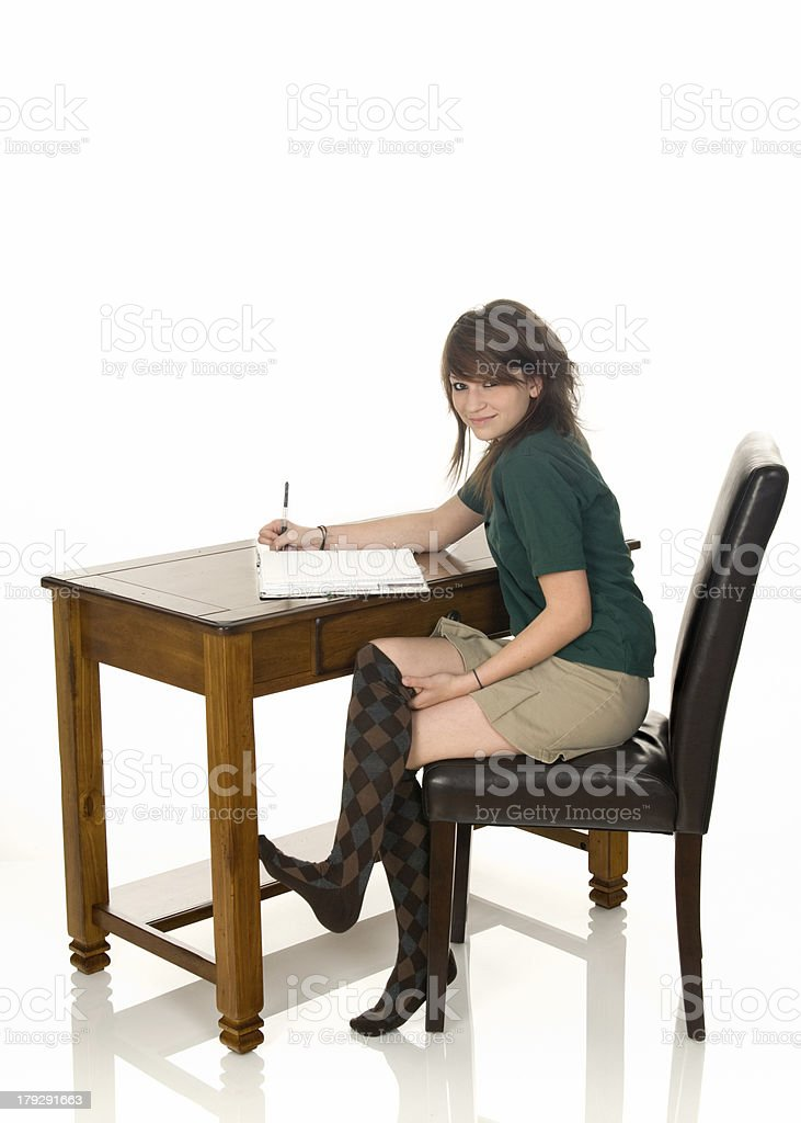 Catholic School Girl Doing Homework royalty-free stock photo