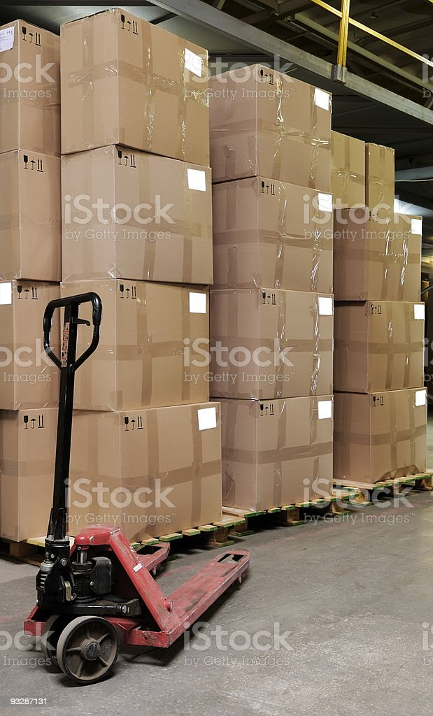 catron boxes and pallet truck in warehouse royalty-free stock photo