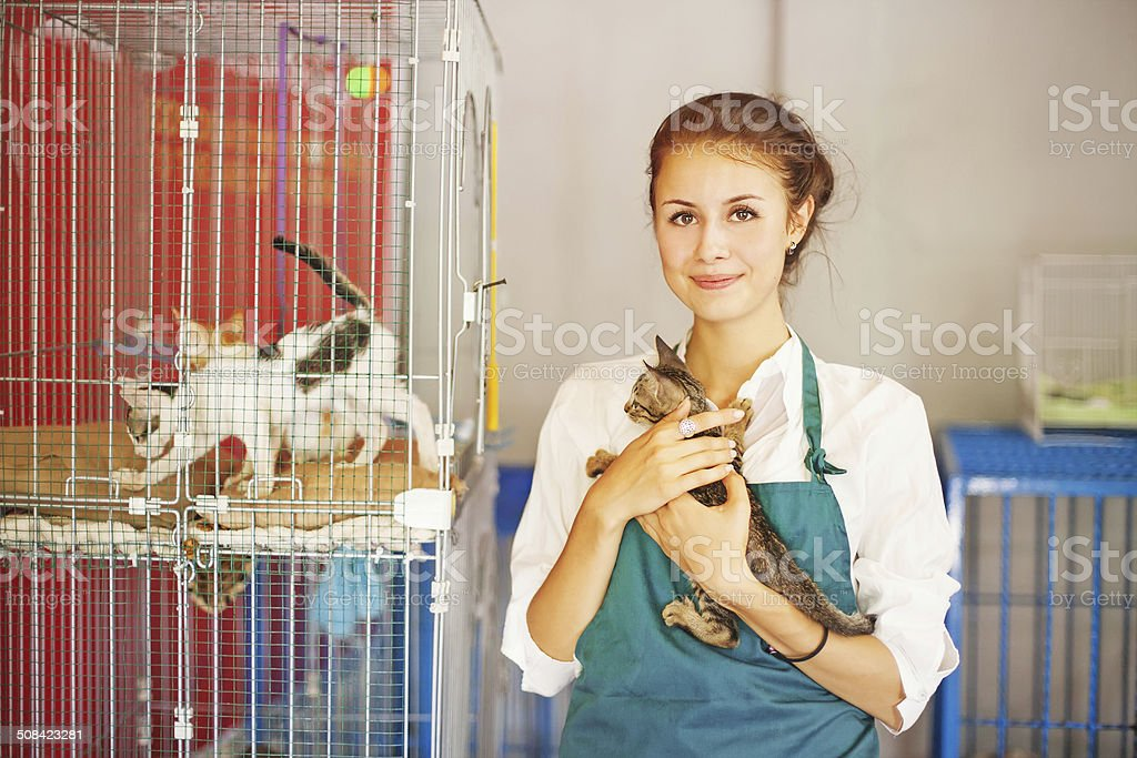 woman working in cats shelter