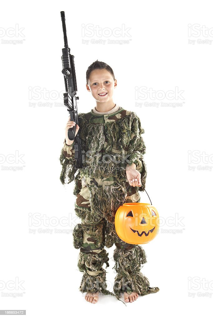 Cauasian boy wearing a soldier outfir for halloween royalty-free stock photo
