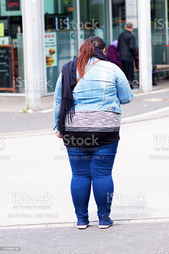 Caucasian adult woman in jeans fashion stock photo