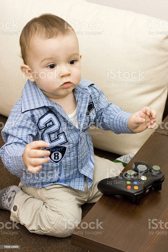 Caucasian baby and joystick royalty-free stock photo