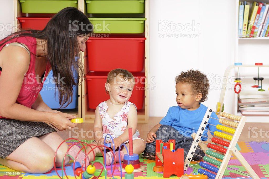 Caucasian Baby Girl Smiling At Playtime stock photo