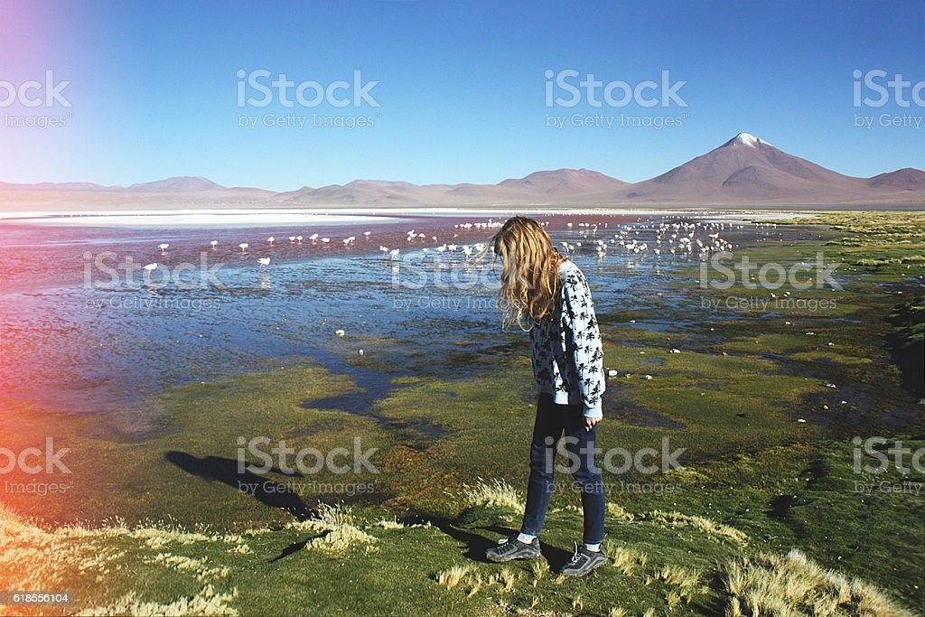caucasian blond girl walking near lagoon Colorada, Bolivia stock photo