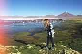 caucasian blond girl walking near lagoon Colorada, Bolivia