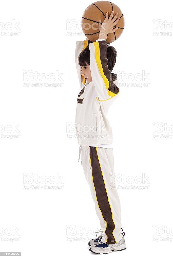 Caucasian boy playing basket ball royalty-free stock photo