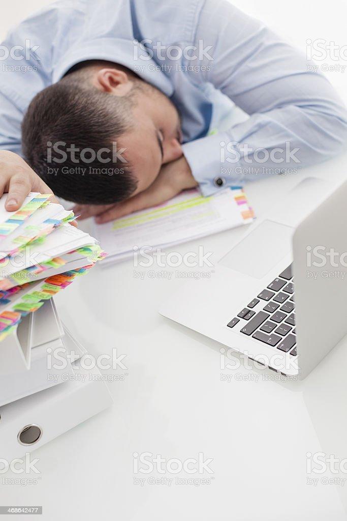 Caucasian businessman asleep at his desk stock photo