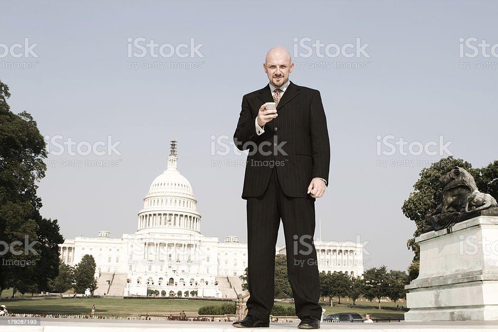 Caucasian Businessman Checks Email Outside U.S. Capitol, Washington DC royalty-free stock photo