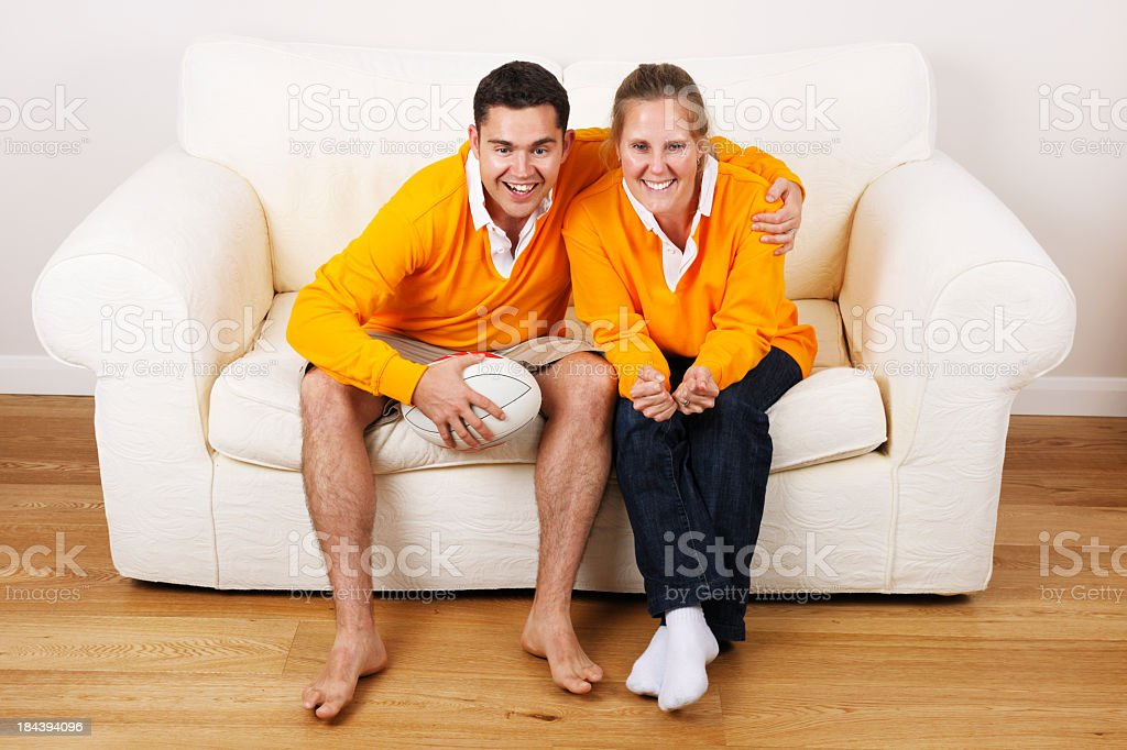 Caucasian Couple Enjoying A Game Of Rugby stock photo