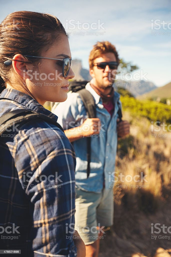 Caucasian couple hiking in nature stock photo