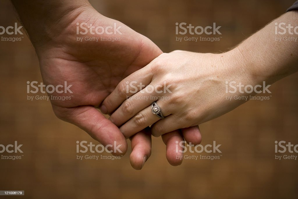Caucasian couple holding hands stock photo